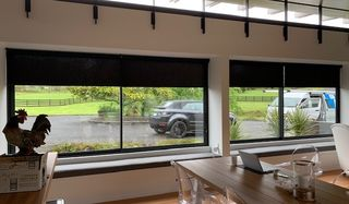 Motorised Light Filtering and Blackout roller blinds in a lifestyle property of Paremoremo