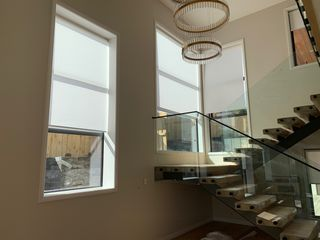 Motorised Roller Blinds for the stairway high window