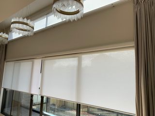 Combine the motorised curtain and motorised Light Filtering Roller blinds