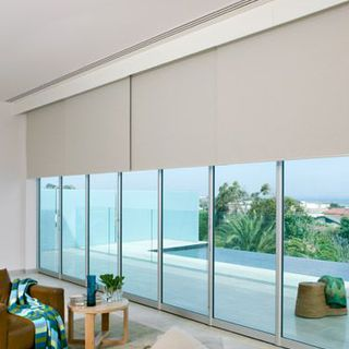 custom-made complete sets of motorised roller blinds